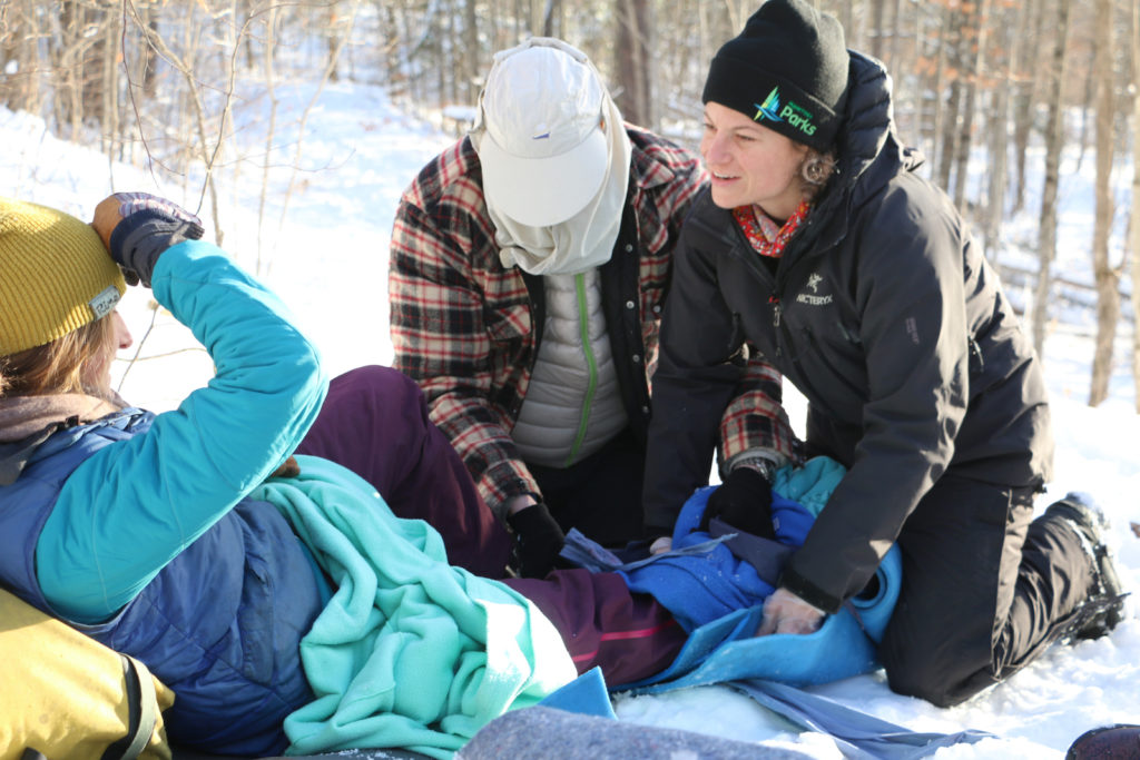 Splinting a leg in a Wilderness First Responder course